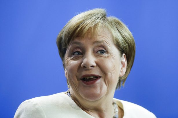 German Chancellor Angela Merkel reacts during a news conference