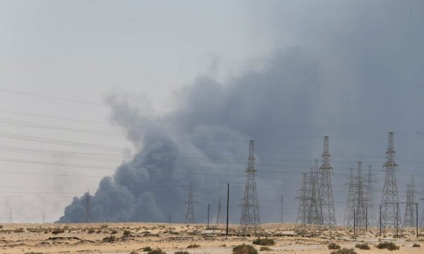 Smoke is seen following a fire at an Aramco factory