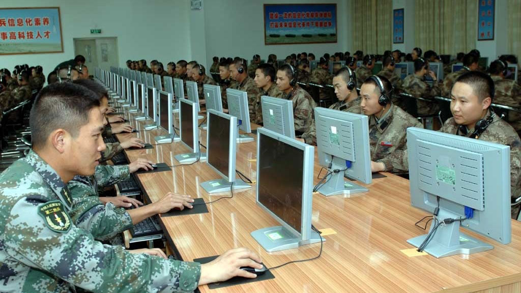 Soldiers with the Second Artillery Corps of the People's Liberation Army work on computers at an undisclosed location. The Chinese regime uses military hackers to feed its economy. (mil.huanqiu.com)