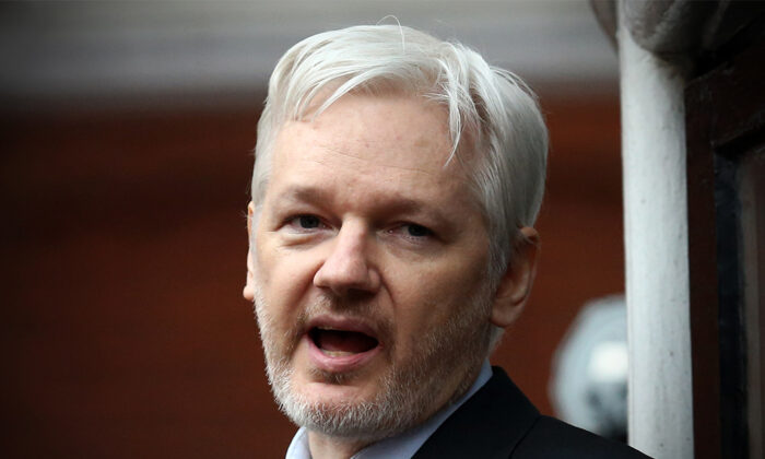 WikiLeaks founder Julian Assange speaks from the balcony of the Ecuadorian embassy in London on Feb. 5, 2016. (Carl Court/Getty Images)