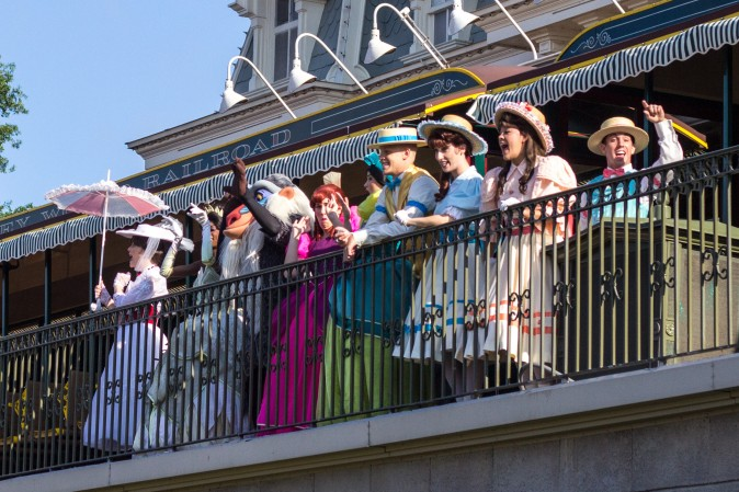 Actors portraying different Disney characters, sing to the crowd during the opening ceremony before the park opens at the Magic Kingdom in Orlando on May 22, 2016. (Benjamin Chasteen/Epoch Times)