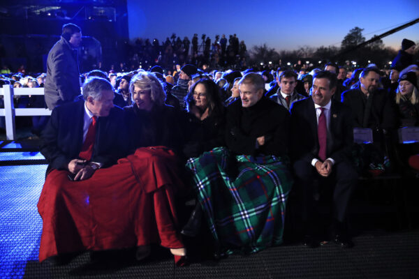 Rep. Mark Meadows, R-N.C., left, Rep. Jim Jordan, R-Ohio, second from right, and Rep. Devin Nunes, R-Calif., right, wait for President Donald Trump and first lady Melania Trump attend the National Christmas Tree lighting
