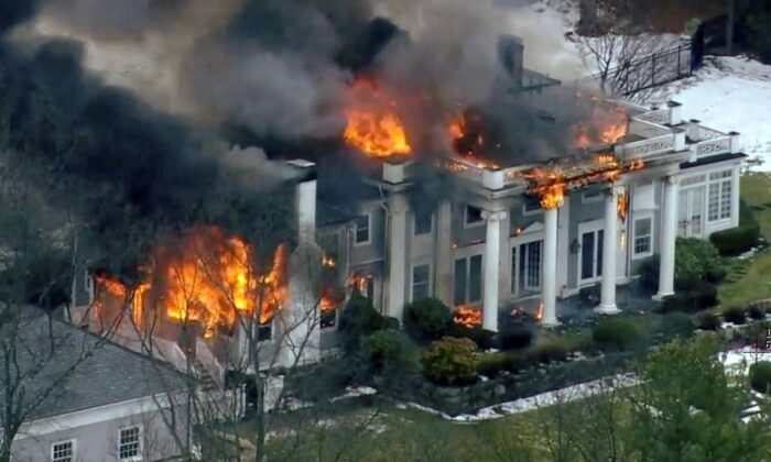 A mansion ablaze in Concord, Mass., on Dec. 27, 2019. (WCVB-TV via AP)